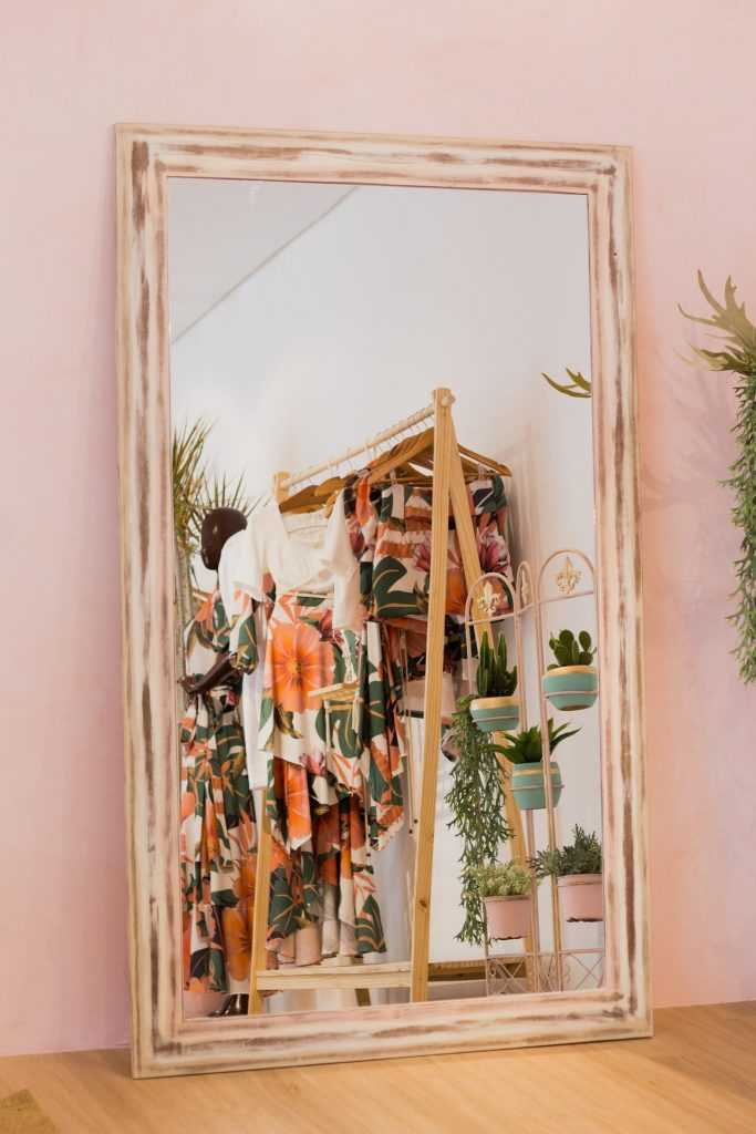 mirror showing clothing for sale